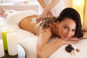 Spa Woman. Brunette Getting a Marine Algae Wrap Treatment in Spa Salon