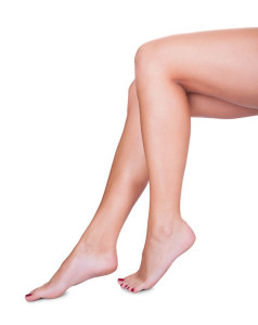 Woman with smooth clean hairless legs after waxing